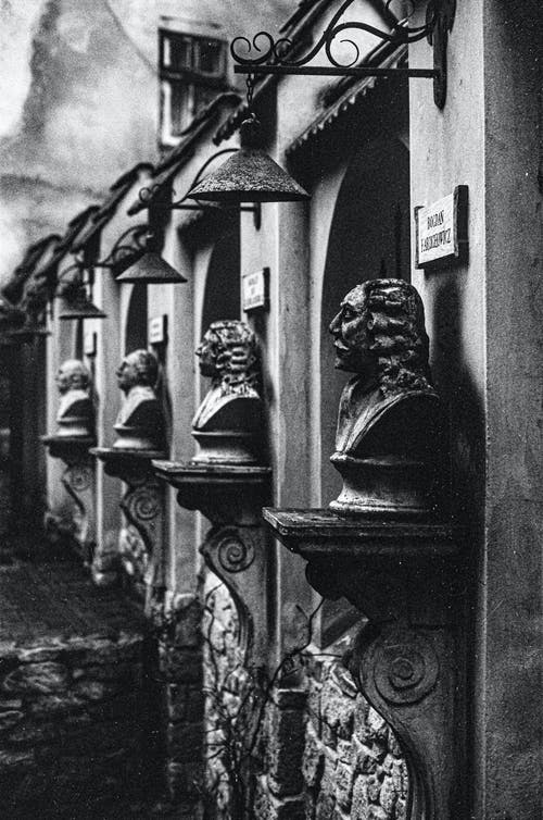 Old building with stone busts of men in town