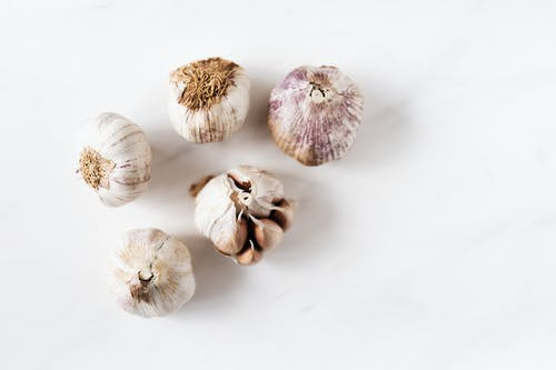 Bunch of raw garlic on marble table