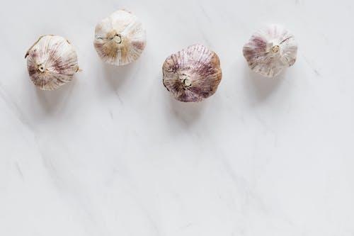 Ripe raw garlic bulbs on marble table