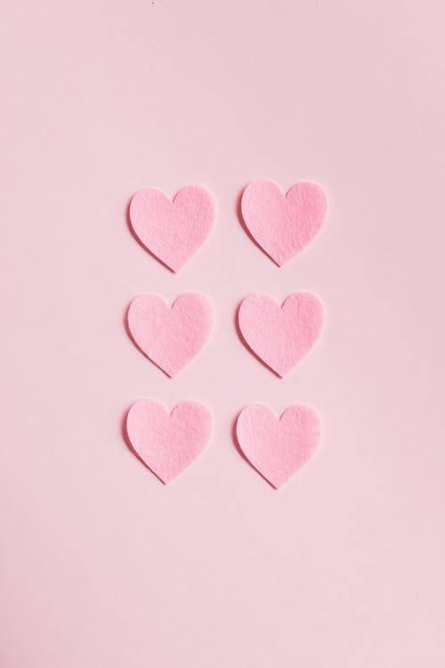 Heart shaped cutouts on pink background