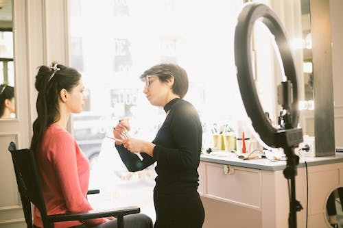 Makeup artist applying makeup on client