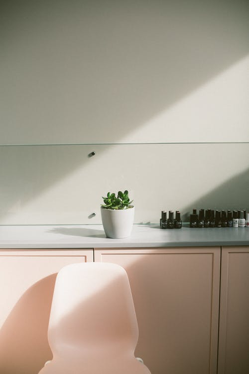 Interior of modern pink bright manicure salon