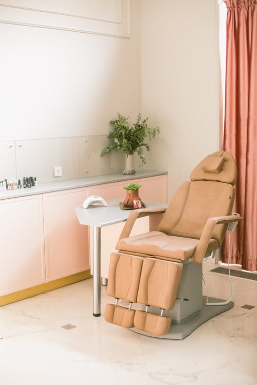 Comfortable procedure chair in stylish manicure studio