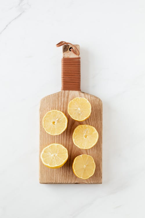 Cutting board with halves of fresh lemons