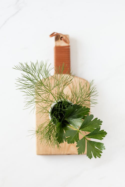 Fresh dill and parsley on cutting board