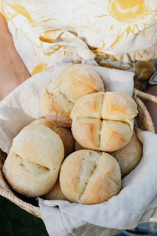 Crop baker with buns in wicker bowl