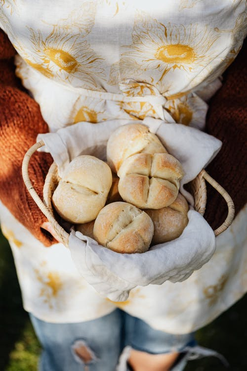Anonymous female baker with homemade buns