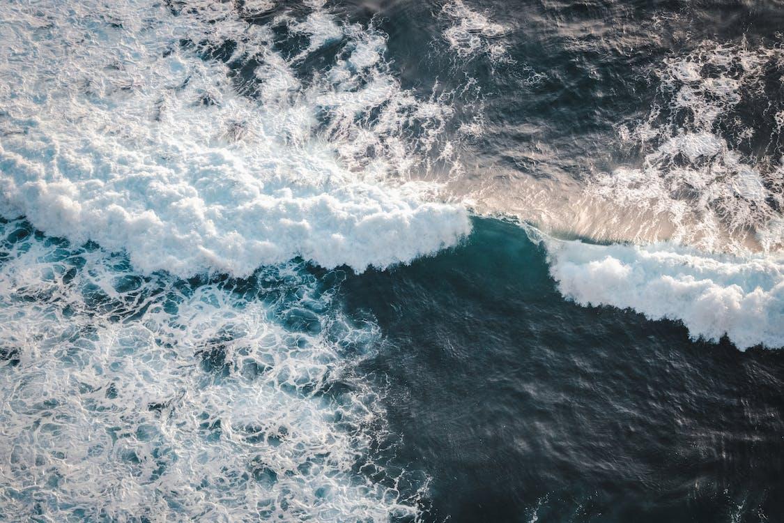 Stormy ocean with foamy waves in daylight