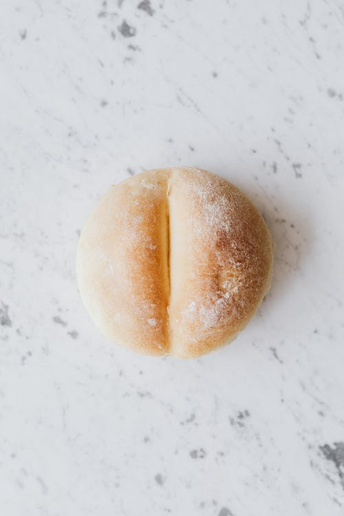 White fresh bread on table in kitchen