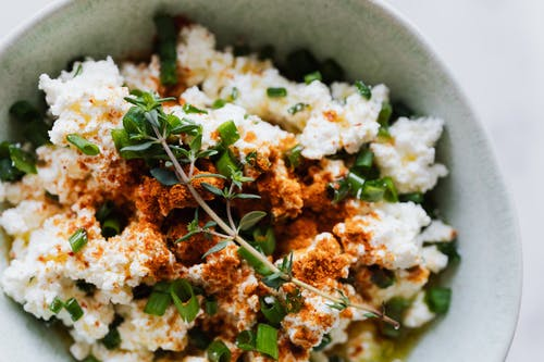Salad with cottage cheese green onion and brunch of thyme
