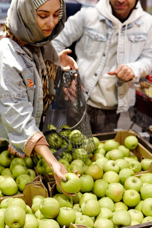 Woman Buying Apples