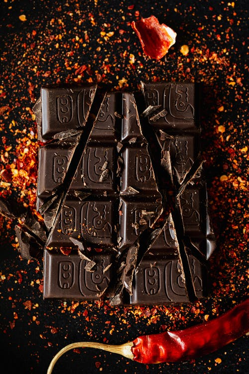 Crushed dark chocolate bar with spices