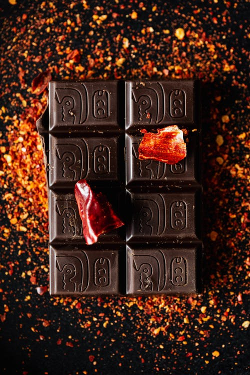 Pieces of hot red pepper on dark chocolate