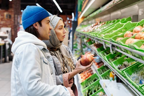 Couple Buying Fruits at a Supermarket