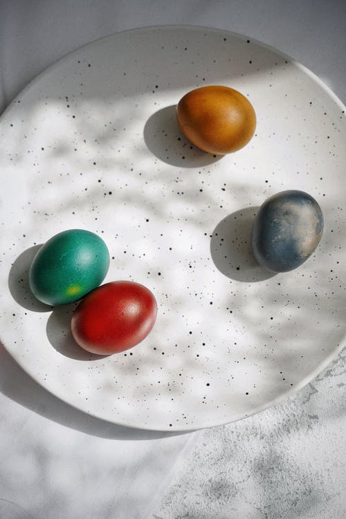 Red Green Yellow and Blue Marble Toys on White Ceramic Plate