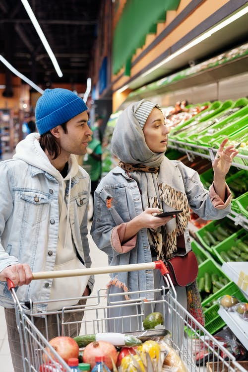 Couple Buying Groceries at a Supermarket