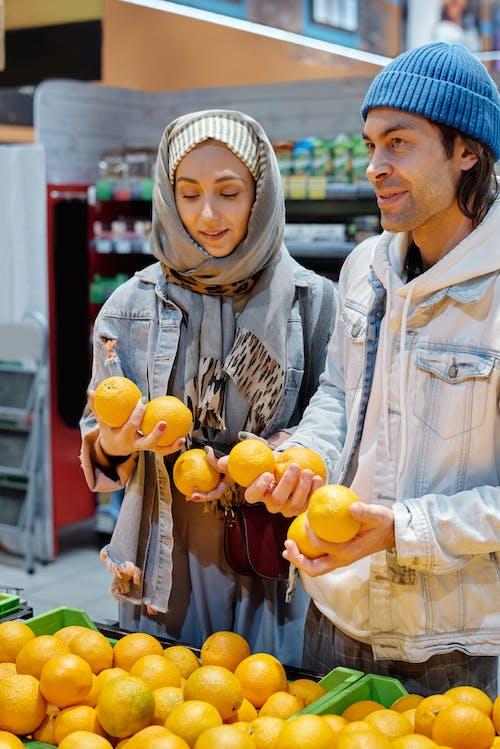 Couple Buying Oranges