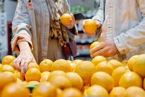 People Buying Oranges