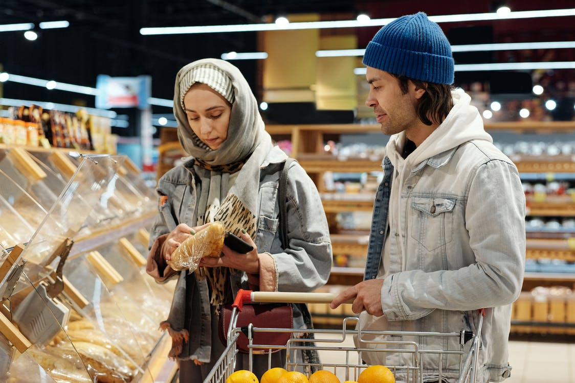 Couple with a Shopping Cart Buying Bread