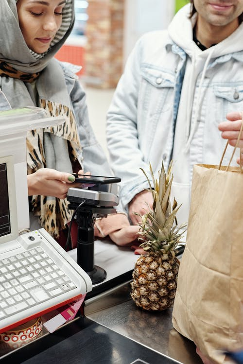 Woman Buying a Pineapple