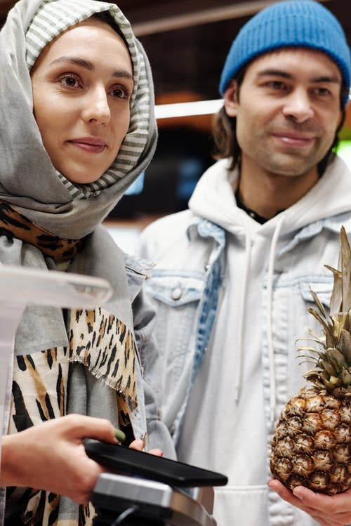 Couple Buying a Pineapple