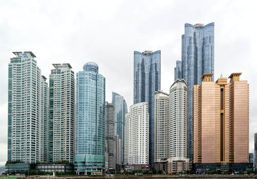 City Skyline Under White Sky