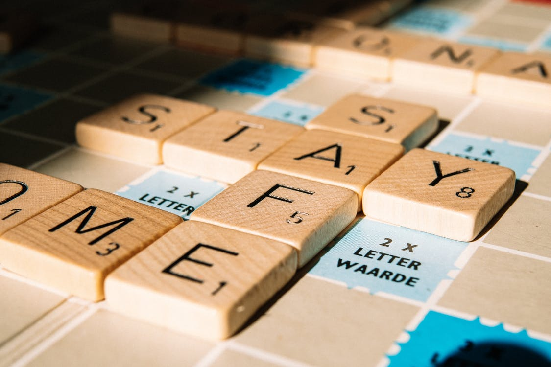 Letter tiles of board game on table