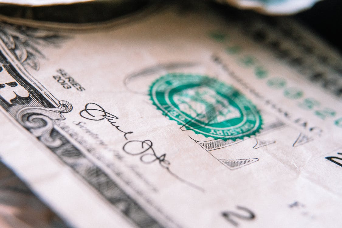 One US dollar banknote on table