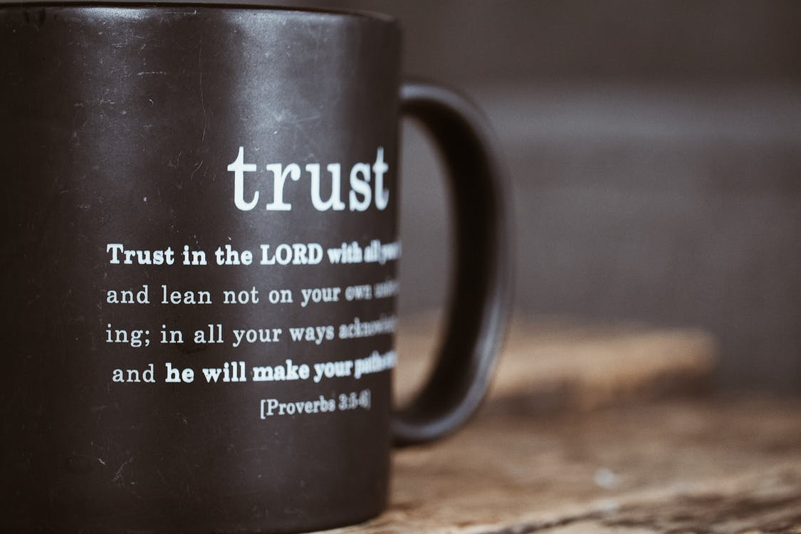 Black mug with proverb from Holy Bible