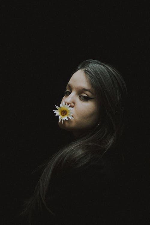 Woman With White Flower on Lips