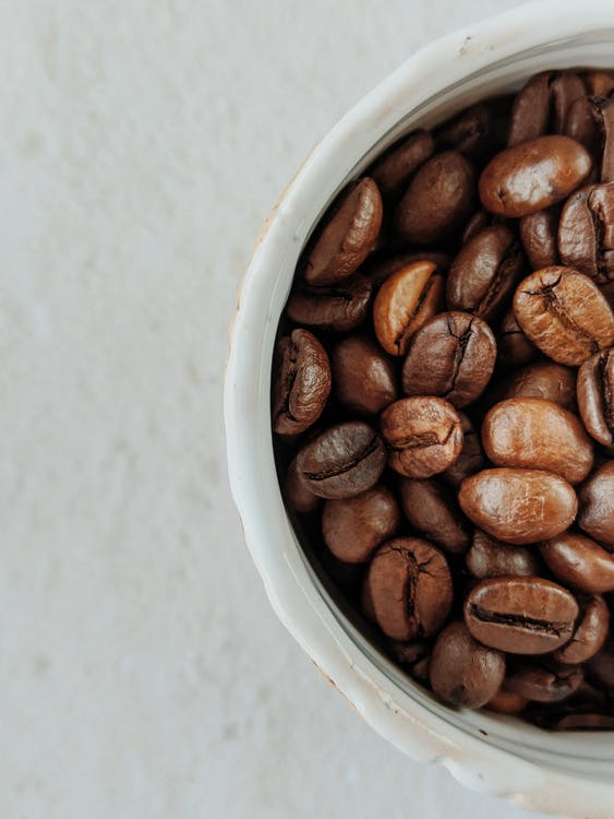 Brown Coffee Beans in White Ceramic Cup