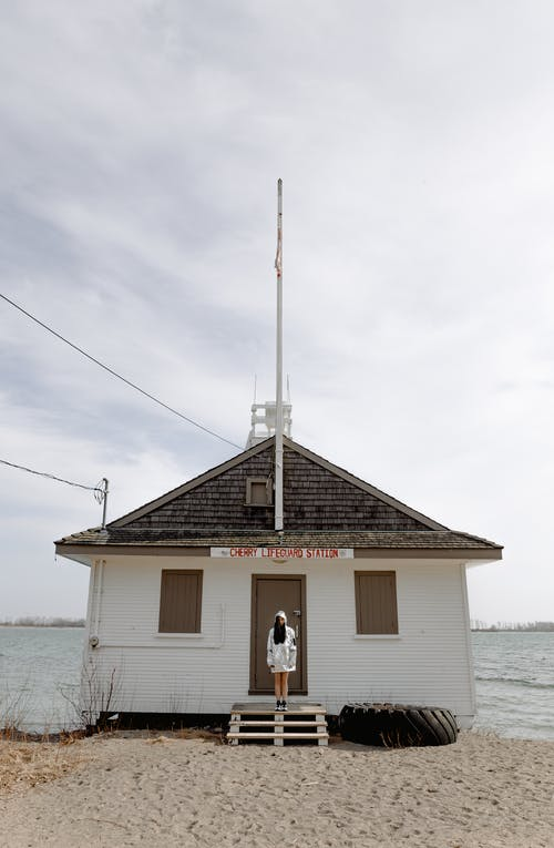 Person Standing in Front of Lifeguard Station