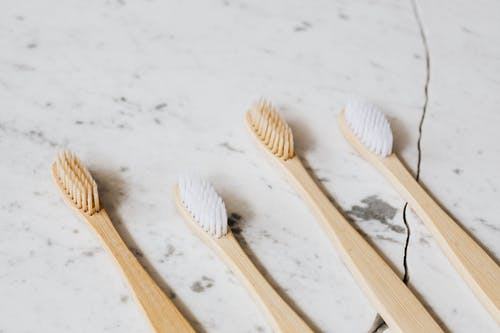 Photo of Four Toothbrush on White Surface