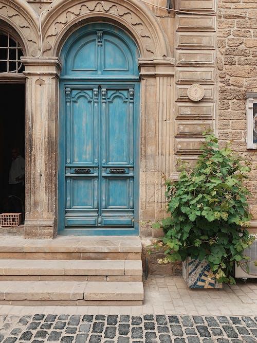 Blue ornamental door of medieval building