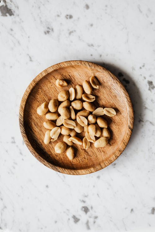 Photo of Peanuts on Brown Wooden Bowl