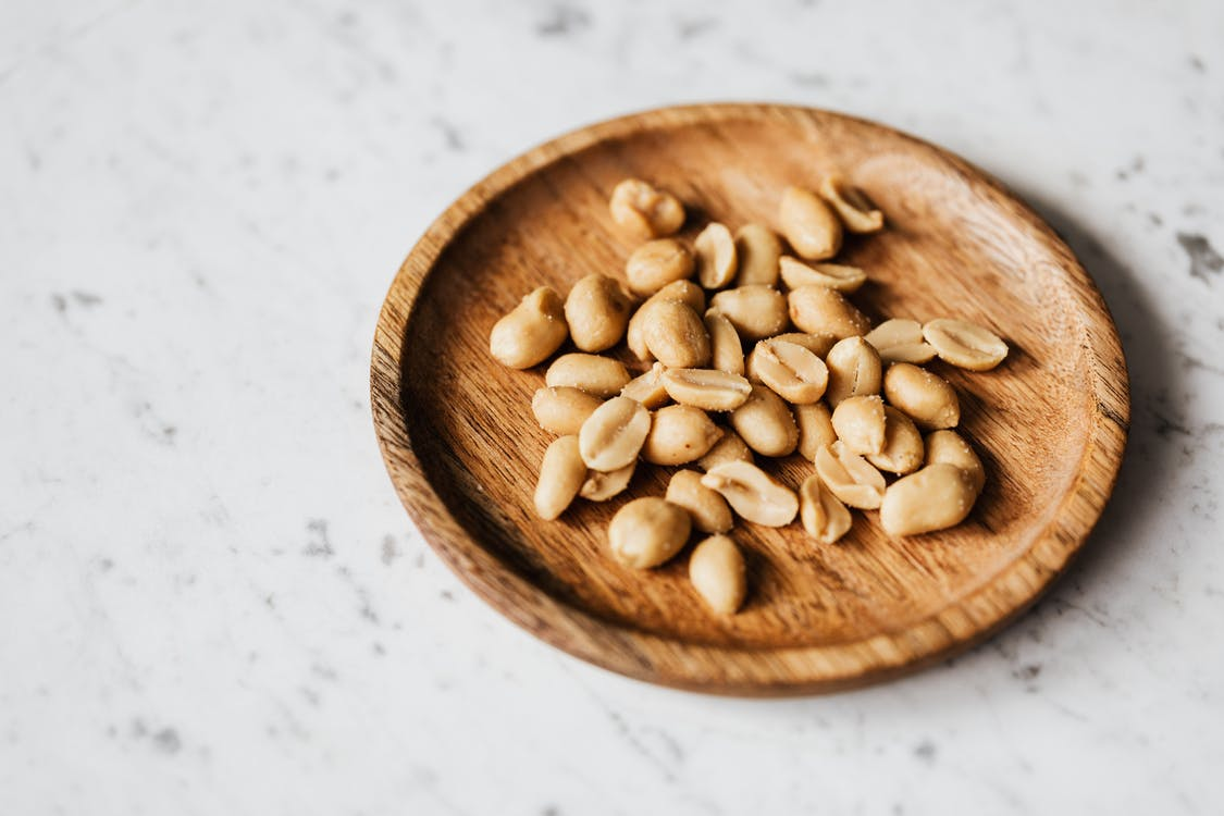 Brown Wooden Round Bowl With Brown Nuts