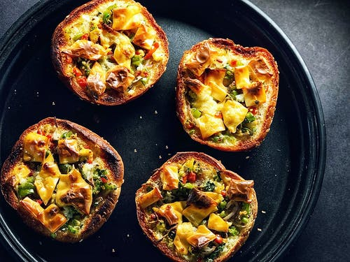 Yummy mini bread pizzas on tray