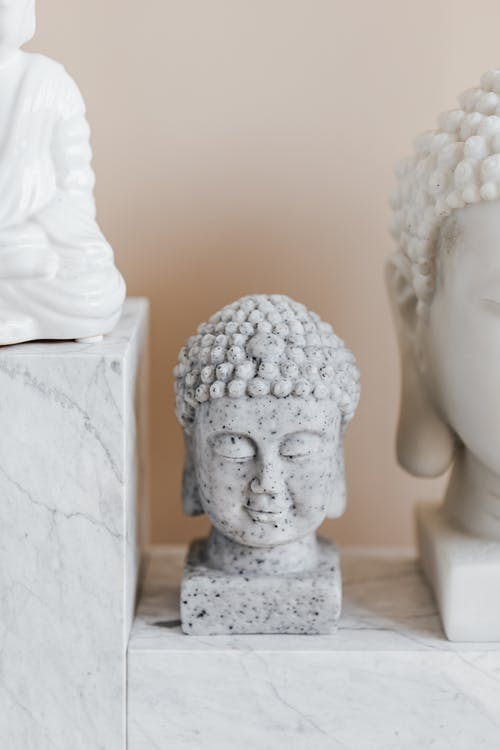 Asian bust of Buddha made of grey stone