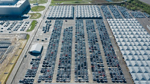 Aerial Photography of Cars Parked on Automobile Storage Facility