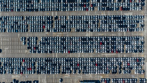 Top View Photo of Cars Parked on Automobile Storage Facility