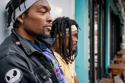 Serious bearded black men chilling on street