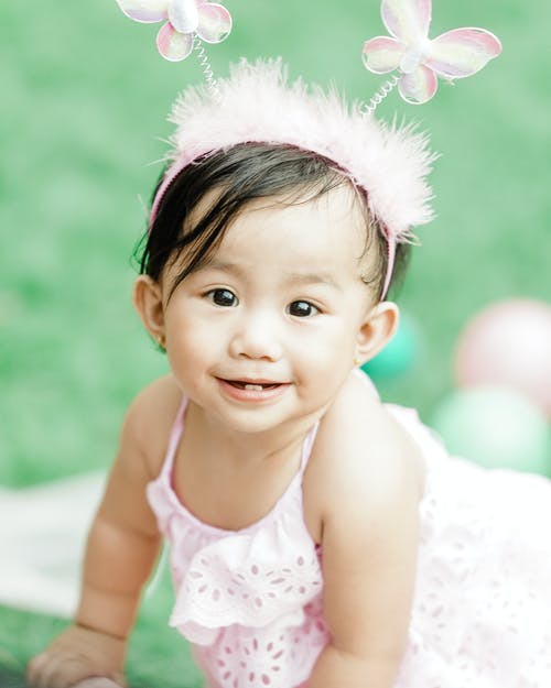 Photo of Baby Girl Wearing Pink Headband