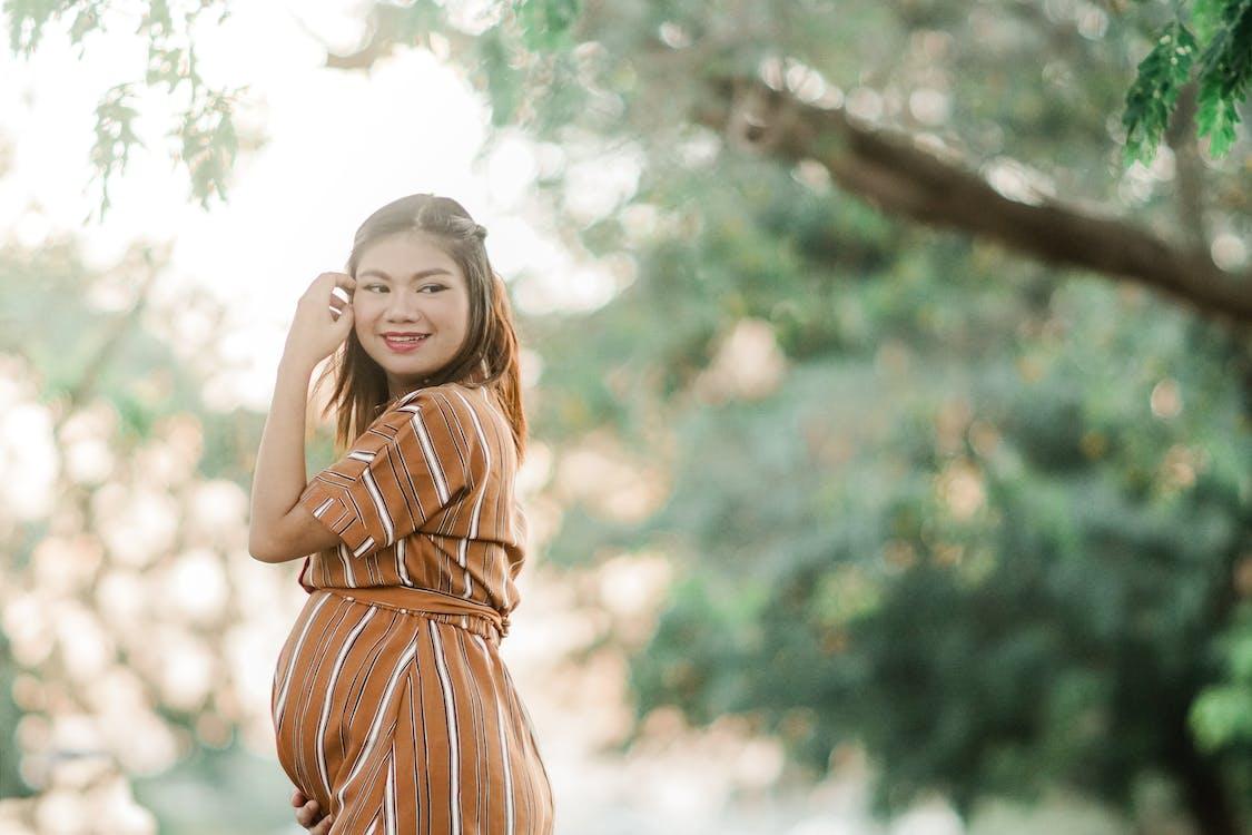 Woman in Brown Dress Smiling