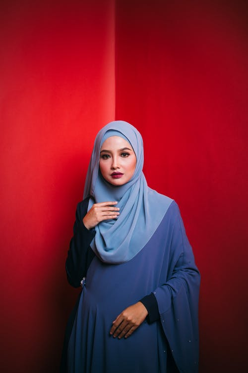 Woman in Blue Hijab and Blue Long Sleeve Shirt