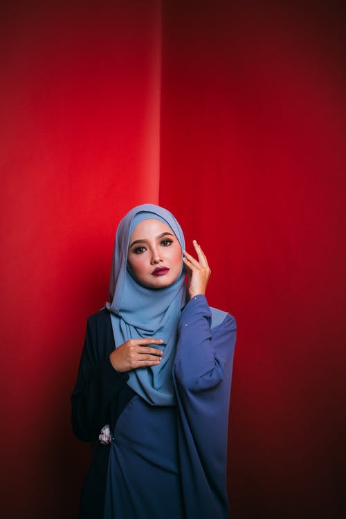 Woman in Blue Long Sleeve Shirt Wearing Blue Hijab
