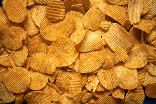 Pile of scattered yummy potato chips