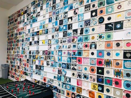 Vintage vinyl discs hanging on wall near foosball in store