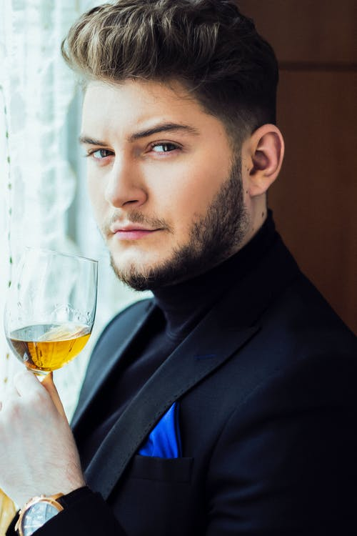 Confident man with glass of wine