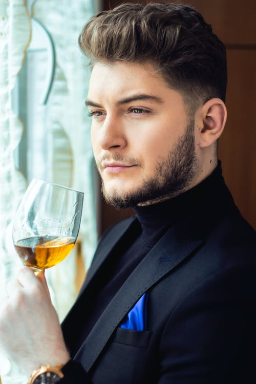 Content man with glass of wine
