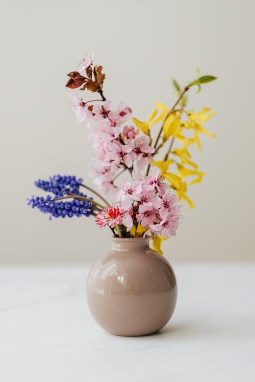 Photo of Flowers in Ceramic Vase